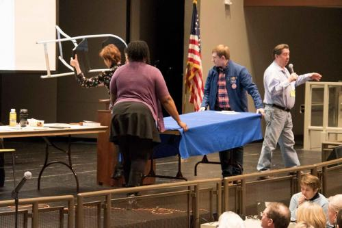 The candidates had to move their own table for the Q&A.