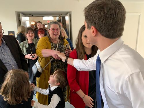 DFL58 chair shakes hands with Buttigieg.